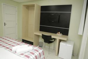 Кровать или кровати в номере LW Hotel