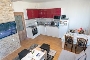 A kitchen or kitchenette at VacationBS - Sea and Lake Panorama