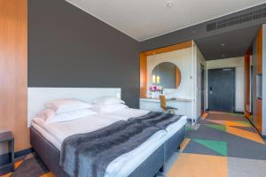 Voodi või voodid majutusasutuse Hotel Sophia by Tartuhotels toas