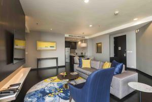 Area soggiorno di Chatrium Hotel Riverside Bangkok