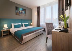 Un ou plusieurs lits dans un hébergement de l'établissement Arcadia Hotel Budapest