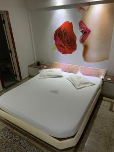 A bed or beds in a room at Hotel Itaoka (Adults Only)