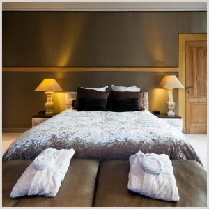 Cama o camas de una habitación en Hotel Le Tissu