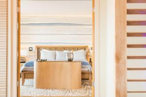 A bed or beds in a room at The Royal Yacht