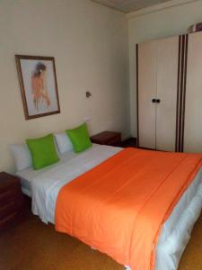 A bed or beds in a room at Hostal Real
