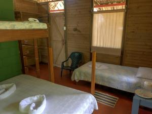 A bunk bed or bunk beds in a room at Pijibá Lodge