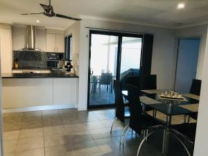 A kitchen or kitchenette at Hervey Bay Holiday Home