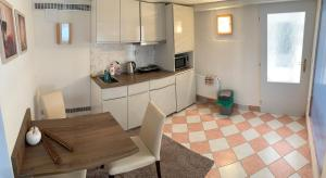 Kuchyň nebo kuchyňský kout v ubytování Vila Linda