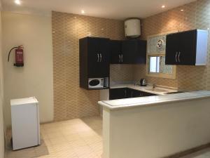 A cozinha ou cozinha compacta de Dgnna
