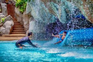 The swimming pool at or near Hilton Phuket Arcadia Resort & Spa (SHA Plus+)