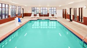 The swimming pool at or near Baymont by Wyndham St. Joseph/Stevensville