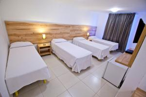 A bed or beds in a room at Hotel Refugio