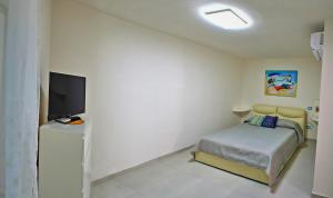 A bed or beds in a room at Casa sul Corso