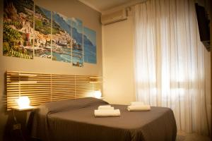 A bed or beds in a room at B&B Salerno Center