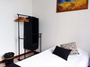 Uma cama ou camas num quarto em Casa da Travessa