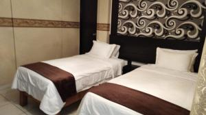 A bed or beds in a room at Monterrico Hotel Perú