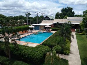 A view of the pool at Scent of Sukhothai Resort or nearby