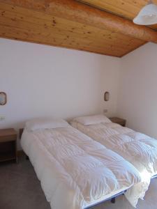 Postel nebo postele na pokoji v ubytování Casa Gembre