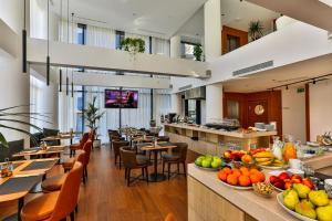 Restoran või mõni muu söögikoht majutusasutuses Villa Dvor Kornic