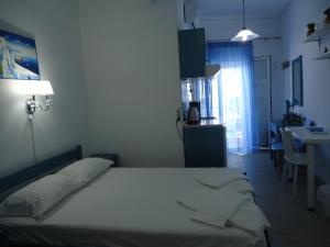 A bed or beds in a room at Kallithea Studios