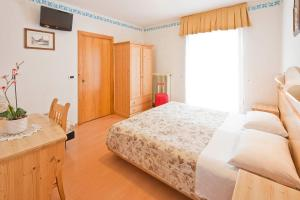 A bed or beds in a room at Albergo San Rocco