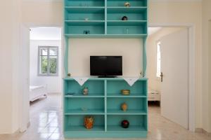 A television and/or entertainment center at Eftihias house