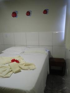 Cama ou camas em um quarto em Casa da Katilcia