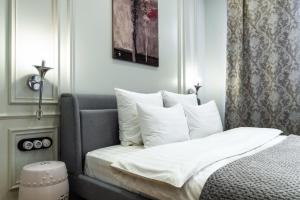 Кровать или кровати в номере D apartments на Рубинштейна