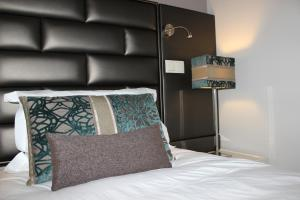 A bed or beds in a room at Aqua Ria Boutique Hotel