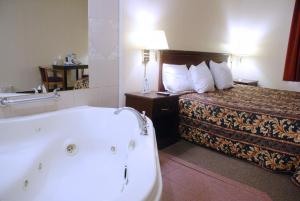 A bed or beds in a room at Days Inn by Wyndham Philadelphia - Roosevelt Boulevard