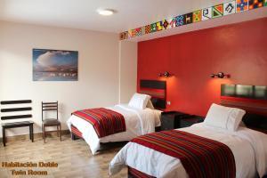 Cama o camas de una habitación en Hotel Tierra Inka Sacred Valley