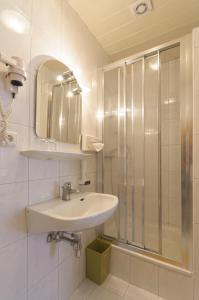 Ein Badezimmer in der Unterkunft Hotel Tautermann