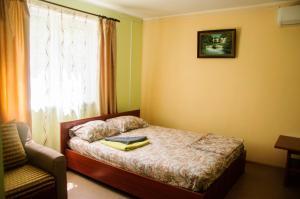 Кровать или кровати в номере Guest House on Il'icha