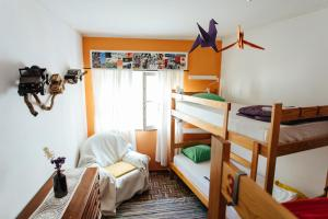 A bunk bed or bunk beds in a room at Olive Hostel Lagos