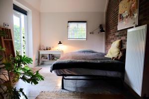 Een bed of bedden in een kamer bij Onder de Appelboom