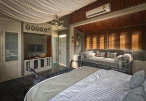 A bed or beds in a room at Reverie Siam