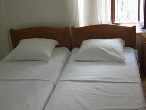 A bed or beds in a room at Rooms Roso