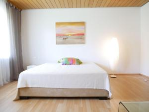 A bed or beds in a room at Haus Vita Ferien- und Seminarhaus