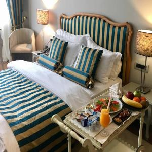 A bed or beds in a room at Classic Hotel