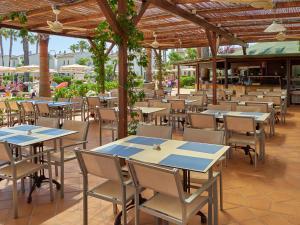 Een restaurant of ander eetgelegenheid bij BQ Alcudia Sun Village