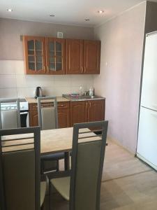 A kitchen or kitchenette at Comfort apartment in Novosibirsk center