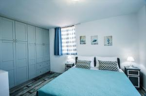 A bed or beds in a room at Villa Dafni