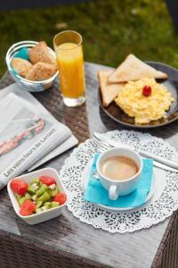 Frühstücksoptionen für Gäste der Unterkunft Hotel De La Pommeraie