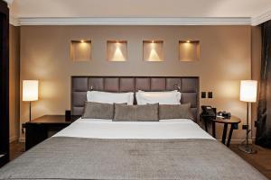 Cama ou camas em um quarto em FULL JAZZ by Slaviero Hotéis