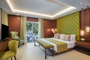 A bed or beds in a room at Movenpick Resort & Spa Boracay