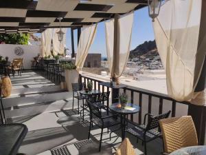 Restauracja lub miejsce do jedzenia w obiekcie Xenones Lindos