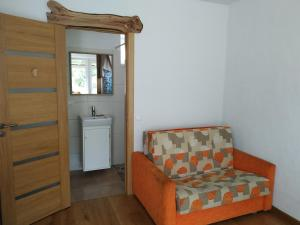 A seating area at 9 min from Palanga! Cosy River Side Studio with sauna