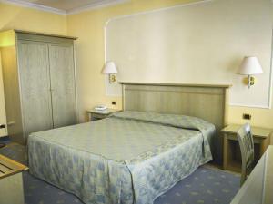 Letto o letti in una camera di Hotel Donatello