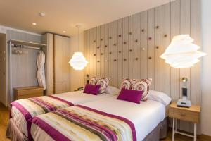 A bed or beds in a room at Grand Palladium White Island Resort & Spa - All Inclusive