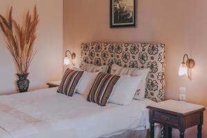 Ένα ή περισσότερα κρεβάτια σε δωμάτιο στο Etheres Tzoumerkon Mountain Resort